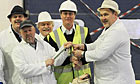 David Cameron holds a Halibut at Grimsby fish market, during an 24-hour campaign tour.