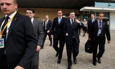 David Cameron walks to an EU summit