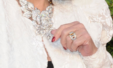 Joan Collins and her red nail varnish