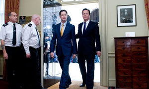 Nick Clegg and David Cameron enter Downing Street together on 11 May