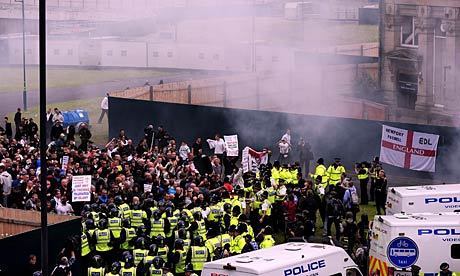 EDL supporters are held in by police in Bradford during a demonstration.
