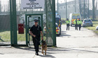 A police dog handler outside Campsfield House immigration centre in Kidlington, Oxfordshire.