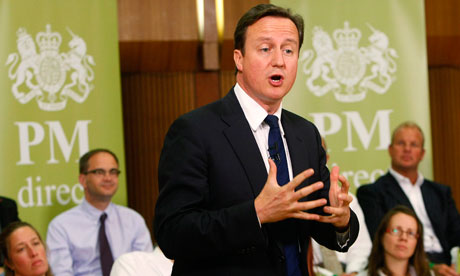 Britain's Prime Minister David Cameron gestures as he speaks in Hove Town Hall in southern England