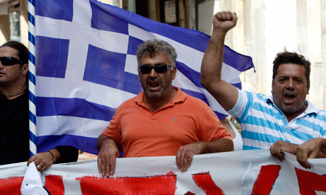 Truck drivers shout slogans as they march through central Athens