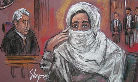 A courtroom sketch of Aafia Siddiqui with Judge Richard Berman in New York.