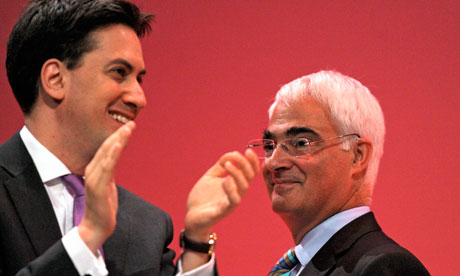 Ed Miliband applauds Alistair Darling after his speech at the Labour party conference in Manchester.