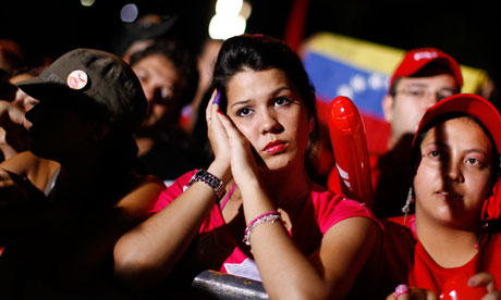 Supporters of Venezuela's President Hugo Chavez listen to the election results in Caracas