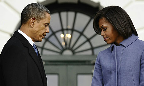 Barack and Michelle Obama observe a moment of silence with White House staff for the Tucson victims