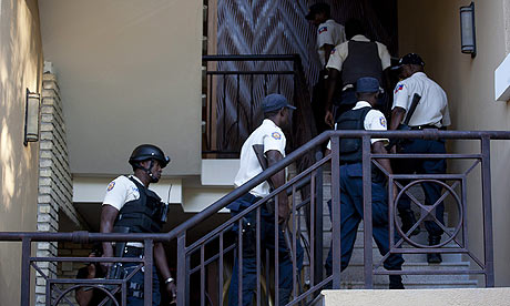 Haiti police go up the stairs at the Hotel Karibe in Port-au-Prince to take Jean-Claude 'Baby Doc' Duvalier into custody. Photograph: Andres Martinez Casares/EPA