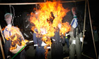 Effigies with Israeli flags of images of Mahmoud Abbas are burned in a Hamas-led protest in Gaza.