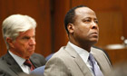 Dr Conrad Murray, right, listens to opening arguments with his attorney J Michael Flannigan