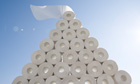 Loo roll piled up in a pyramid