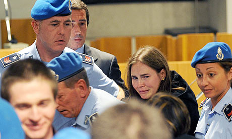 Amanda Knox weeps as she is led from the court after winning her appeal in Perugia.
