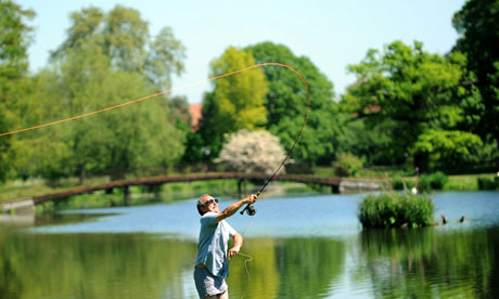 A fisherman at Syon Park fishery, near Brentford