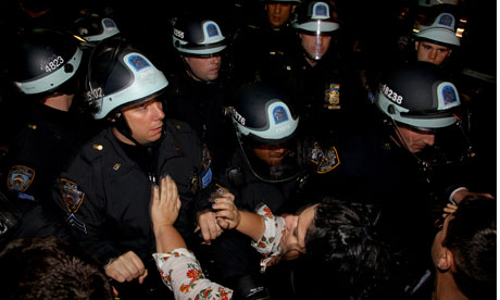 Demonstrators clash with police at the encampment at Zuccotti Park