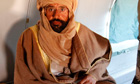 Saif al-Islam Gaddafi is seen sitting in a plane in Zintan