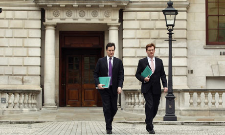 Chief secretary Danny Alexander, right, leaves the Treasury with George Osborne