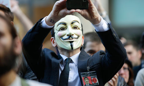 A protester at Occupy Seattle wears a V for Vendetta Guy Fawkes mask. Photograph: Ted S Warren/AP