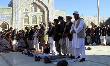 Afghan Muslims offer Eid al-Adha prayers in Herat, Afghanistan. A ...
