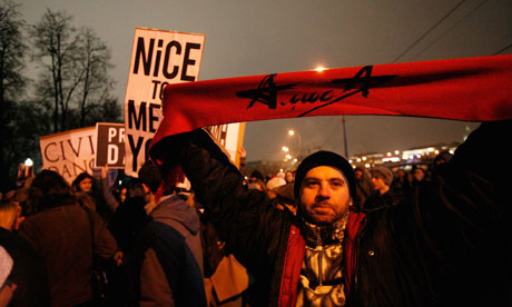 A protester holds up a scarf in Bolotnaya Square. Moscow.