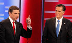 Rick Perry speaks as Mitt Romney looks on