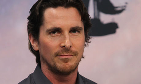 Christian Bale was seen in footage shot by CNN being shoved by guards as he ...