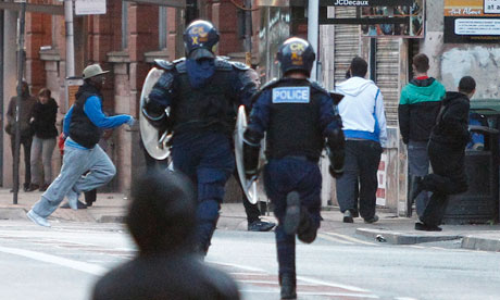 police and young people on the streets of Manchester during the riots