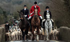 hounds and riders on boxing day hunt in lacock, wiltshire