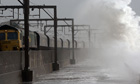 Waves sweep over the railway line in North Ayrshire.