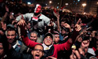 Egyptians celebrate the news of the resignation of Hosni Mubarak
