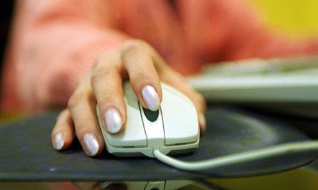 A woman using a PC computer mouse.