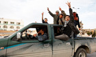 Protesters chant anti-government slogans in Tobruk, Libya.