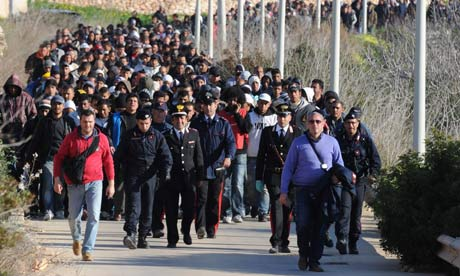 Tunisian migrants arrive in Italy