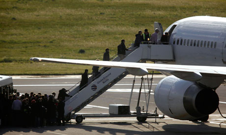 British nationals board plane to London after being evacuated from Libya