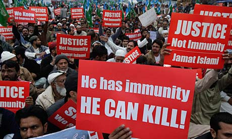 Supporters of the religious party Jamaat-e-Islami rally against CIA employee Raymond Davis, accused of murdering two Pakistanis.