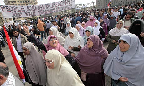 Female protesters shout anti-government slogans in Tahrir Square, Cairo.