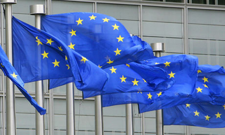 EU flags are seen outside the European Commission headquarters in Brussels