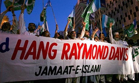 Jamaat-e-Islami party supporters hold a protest against the release of Raymond Davis, in Karachi.