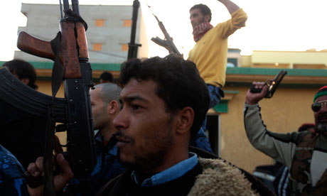Libyan rebels parade with their guns in