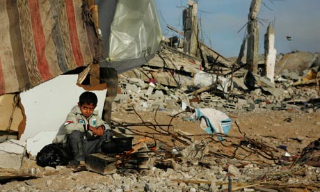 Palestinian boy in ruins of his home boiling eggs