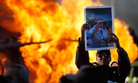 Man holds Gaddafi poster in Tripoli