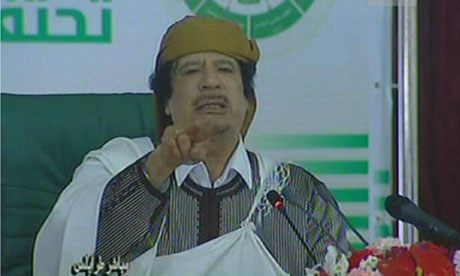 Libyan leader Muammar Gaddafi addresses loyalists of his regime during a public rally in Tripoli