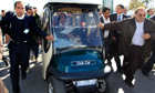 Libyan leader Muammar Gaddafi drives his personal cart in Tripoli