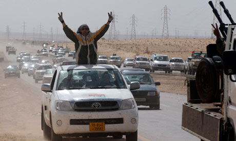 Libyan rebels flee after soldiers loyal to Gaddafi shell the Benghazi-to-Ajdabiya road