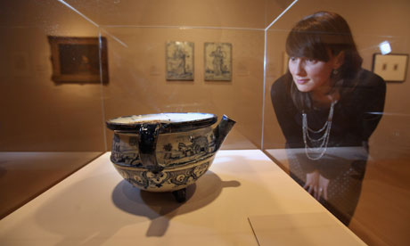 A 17th century Dutch chamber pot on display