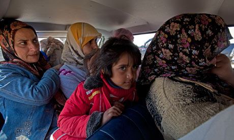 Civilian refugees flee the eastern Libyan town of Ajdabiya