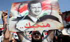 Syrians rally to show their support for President Bashar al-Assad.