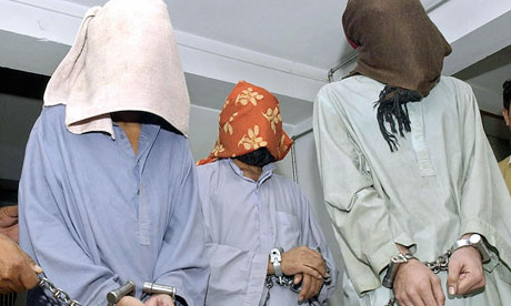 Suspected members of the Baloch Liberation Army are paraded by Pakistani police. Photograph: Banaras Khan