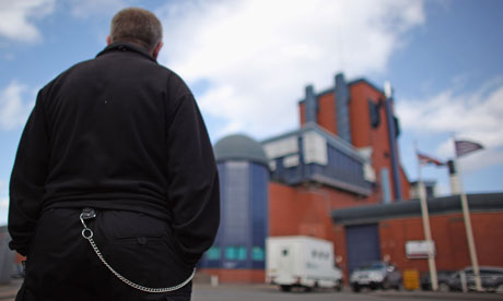 A prison officer outside HM Prison Birmingham at Winson Green, which is privatised.