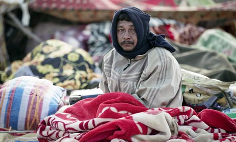 A refugee who fled the fighting in Libya wake up in Ras Jedir, Tunisia